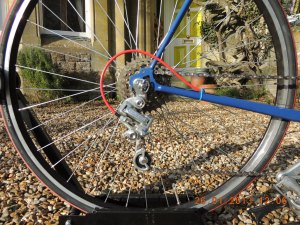 With a wide-range freewheel like this Suntour 14-30, you need to select a derailleur that can handle the largest cog. The Suntour VGT-X does this admirably.