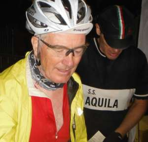 I arrive relieved and exhausted at the end of the L'Eroica 205km ride in 2012. Gary Smith from Yorkshire in the background checking he has all the stamps on his card. Thanks to Gary's brother for the photo - not at my best!