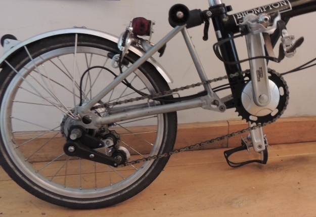 The 8-speed Brompton chainset and tensioner installed. Note the much smaller front chainring