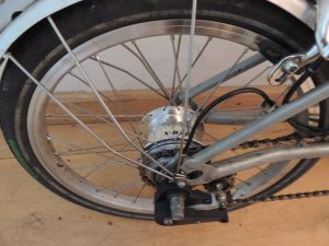 The Sturmey Archer 8-speed hub at the centre of the new wheel