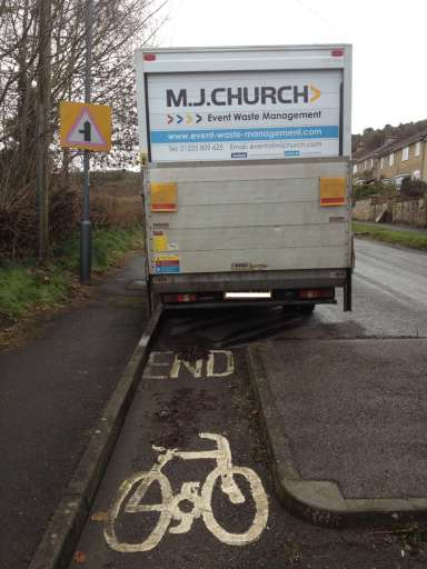 A dysfunctional cycle lane caused by an inconsiderate driver on Bathford Hill, near Bath, UK